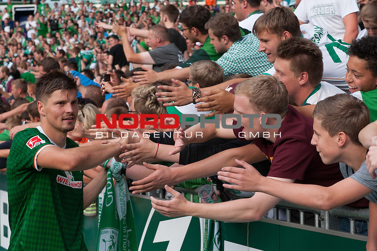 17.08.2013, Weser Stadion, Bremen, GER, 1.FBL, Werder Bremen vs FC Augsburg, im Bild<br /> <br /> Jubel Emotionen pur <br /> <br /> Sebastian Pr&ouml;dl / Proedl (Bremen #15)<br /> bei den Fans  <br /> Foto &copy; nph / Kokenge