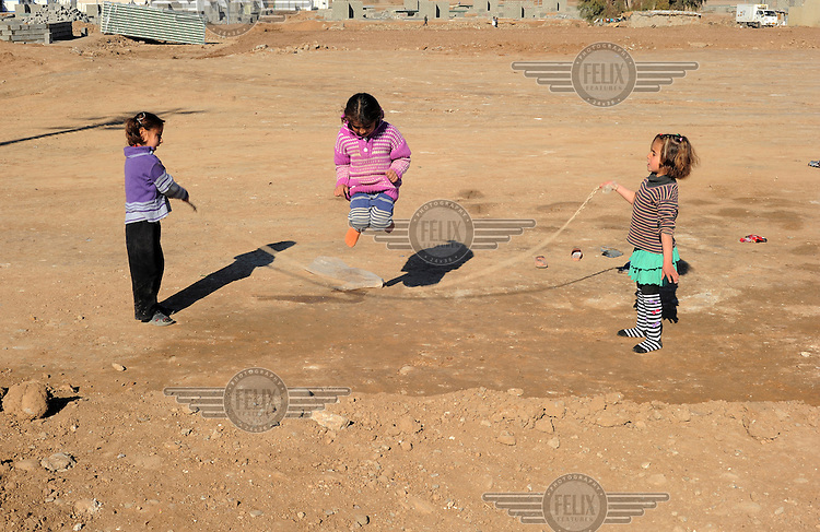 Girls playing with a skipping rope in the Kawergosk Syrian Refugee Camp.