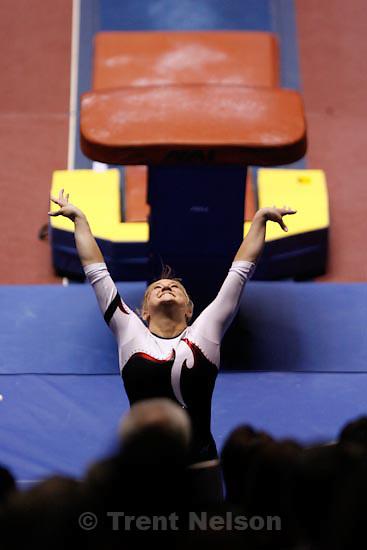 Trent Nelson  |  The Salt Lake Tribune.Salt Lake City - Utah's Kyndal Robarts on the vault, Utah vs. BYU college gymnastics Friday, March 26, 2010.