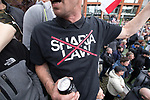 "© Joel Goodman - 07973 332324 . 11/06/2017 . Manchester , UK . A demonstrator wearing a No Sharia Law t-shirt . Demonstration against Islamic hate , organised by former EDL leader Tommy Robinson's "" UK Against Hate "" and opposed by a counter demonstration of anti-fascist groups . UK Against Hate say their silent march from Piccadilly Train Station to a rally in Piccadilly Gardens in central Manchester is in response to a terrorist attack at an Ariana Grande concert in Manchester , and is on the anniversary of the gun massacre at the Pulse nightclub in Orlando . Photo credit : Joel Goodman"