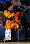 3 December 2006: Buffalo News photographer James McCoy checks his gear during a game between the Buffalo Bills and the San Diego Chargers at Ralph Wilson Stadium in Orchard Park, New York. The Charges defeated the Bills 24-21. Mandatory Photo Credit: Ed Wolfstein Photo<br />