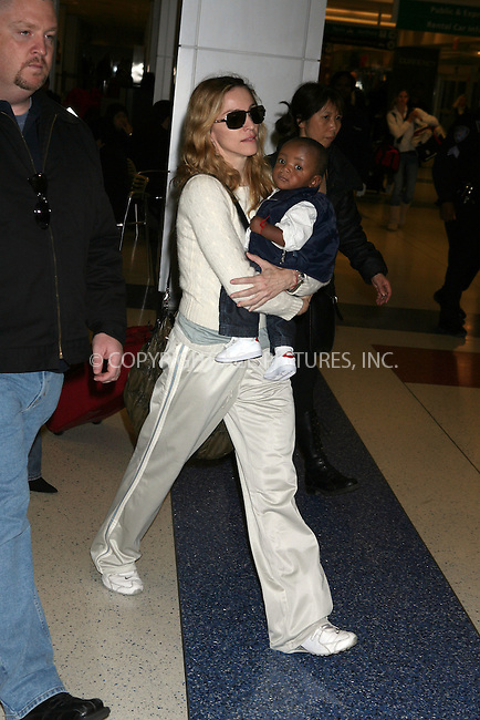 WWW.ACEPIXS.COM..........October 29 2006, New York City....Singer Madonna arriving in New York City with her newly adopted Malawian son David Banda.......Please byline: PHILIP VAUGHAN/ACEPIXS.COM....For information please contact Philip Vaughan:..tel: 212 243 8787 or 646 769 0430..e-mail: info@acepixs.com..website: www.acepixs.com