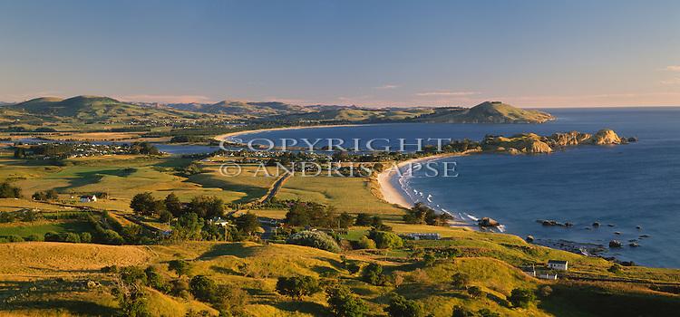 Early morning light on the coastline near Karitane. Otago Region. New Zealand.