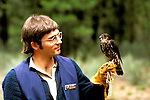 Oregon: Bend, High Desert Museum, bird of prey, handler,  Photo: orbend103.Photo copyright Lee Foster, www.fostertravel.com, 510/549-2202, lee@fostertravel.com