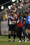 20 March 2004: DC United's rookie head coach Peter {Piotr) Nowak (right) discusses strategy with Dema Kovalenko (21) during the first half. DC United of Major League Soccer defeated the Charleston Battery of the A-League 2-1 at Blackbaud Stadium in Charleston, SC in a Carolina Challenge Cup match..