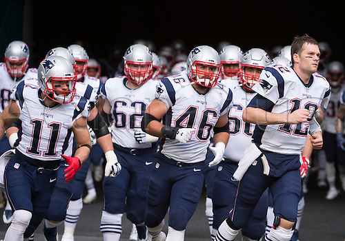 01.01.2017. Miami Gardens, Florida, USA.  New England Patriots Quarterback Tom Brady (12) leads New England Patriots Wide Receiver Julian Edelman (11), New England Patriots Guard Joe Thuney (62), New England Patriots Fullback James Develin (46) and the rest of the team on to the field during the NFL football game between the New England Patriots and the Miami Dolphins on January 1st 2017, at the Hard Rock Stadium in Miami Gardens, FL.