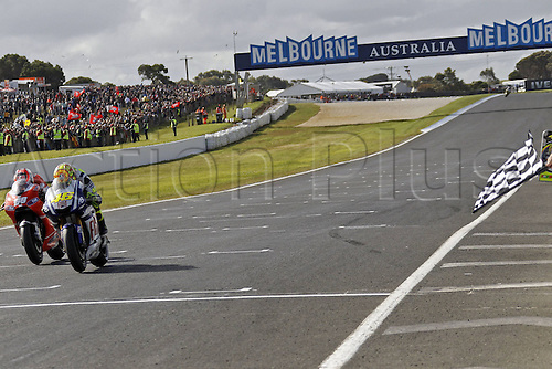 17 10 2010  17 10 2010 Phillip Island Australia.  MotoGP  Photo Valentino Rossi Fiat Yamaha team and Nicky Hayden Ducati team  cross the finish line