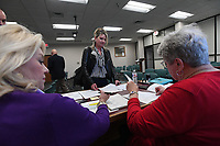 NWA Democrat-Gazette/J.T. WAMPLER Shannon Marti (center) files her paperwork with the Republican Party Monday Nov. 4, 2019 to run for Justice of the Peace for district 2 in Washington County. Volunteers Susan Gessler (left) and Nancy Johnson assist Marti with the paperwork.