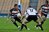 Siale Piutau looks to step Harbour replacement prop Sam Biddles. Air New Zealand Cup rugby game between Counties Manukau Steelers & North Harbour, played at Mt Smart Stadium on Saturday 4th of  October 2008. After being tied up 14 all at halftime North Harbour went on to win 57 - 28.