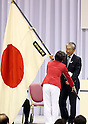 July 3, 2016, Tokyo, Japan - Head of Japanese delegation Seiko Hashimoto (L) receives a large national flag from Japan Olympic Committee (JOC) president Tsunekazu Takeda at the ceremony to form Japanese Olympic delegation for Rio de Janeiro in Tokyo on Sunday, July 3, 2016. Japanese Crown Prince Naruhito and Crown Princess Masako attended the event.  (Photo by Yoshio Tsunoda/AFLO) LWX -ytd-