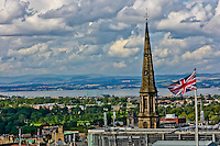 An arial view over Edinburgh with a Union Jack in the foreground
