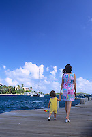 Mother and Child walking along waterfront, Christiansted Marina, St. Croix, U.S. Virgin Islands