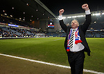 Ally McCoist salutes the Rangers fans after winning the League