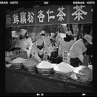 Chinese vendors sell traditional beverages at a temple fair during the Chinese New Year in Beijing, China, February, 2014. (Mamiya 6, 75mm, Kodak TRI-X film)