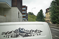 Switzerland. Canton Graubünden. Davos. Town center. Modern and traditional architecture. An alpine drawing on a van. 11.07.2020 © 2020 Didier Ruef