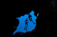 Divers (MR) pictured at the enterance to an underwater lava tube off the Island of Lanai, Hawaii.
