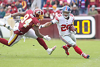 Landover, MD - December 9, 2018: New York Giants running back Saquon Barkley (26) breaks Washington Redskins outside linebacker Preston Smith (94) tackle during the  game between New York Giants and Washington Redskins at FedEx Field in Landover, MD.   (Photo by Elliott Brown/Media Images International)