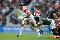 Luke Thompson of Japan takes on the South Africa defence. Luke Thompson of Japan takes on the South Africa defence. Rugby World Cup Pool B match between South Africa and Japan on September 19, 2015 at the Brighton Community Stadium in Brighton, England. Photo by: Patrick Khachfe / Stewart Communications