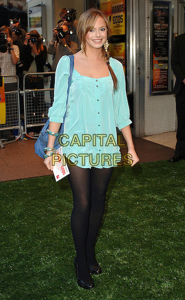 "HANNAH TOINTON.Attending the World Charity Premiere of ""In The Hands Of The Gods"", Odeon West End, London, England..September 10th, 2007.full length Hanna green shirt dress minin tunic black tights shoes blue bag hand on hip plait braid.CAP/ BEL.©Tom Belcher/Capital Pictures."