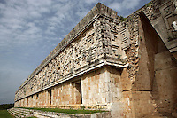 Corner with Masks of Chaac, God of rain with all the façade in the distance, False Arch, Governor?s Palace, 900-1000 AD, Puuc architecture, Uxmal late classical Mayan site, Yucatan, Mexico Picture by Manuel Cohen