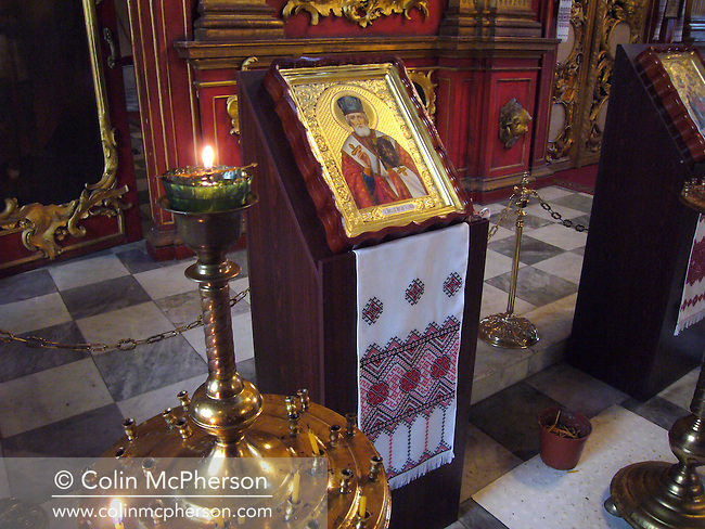 The interior of a Catholic church on Andrew's Descent in Kiev. The city of Kiev, known as Kyiv in Ukrainian, suffered substantial damage during World War 2 and its infrastructure has continued to suffer from under-investment despite a growing economy since Ukrainian independence. Ukraine was a republic within the former Soviet Union which broke away from the USSR and formed its own sovereign state in August 1991 although the eastern half of the country still maintained close links with Russia.