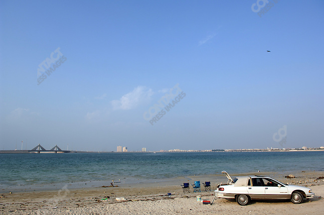 On a holiday a family took a picnic to a beach on the waterfront of the Bahraini capital, Manama, December 18, 2005.