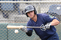 Logan Taylor (22) of the Everett AquaSox practices his bunting before a game against the Spokane Indians at Everett Memorial Stadium on July 25, 2015 in Everett, Washington. Spokane defeated Everett, 10-1. (Larry Goren/Four Seam Images)