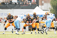 September 7, 2009; Hamilton, ON, CAN; Hamilton Tiger-Cats offensive lineman Marwan Hage (62) offensive lineman Peter Dyakowski (67) offensive lineman Alexandre Gauthier (66). CFL football - the Labour Day Classic - Toronto Argonauts vs. Hamilton Tiger-Cats at Ivor Wynne Stadium. The Tiger-Cats defeated the Argos 34-15. Mandatory Credit: Ron Scheffler.