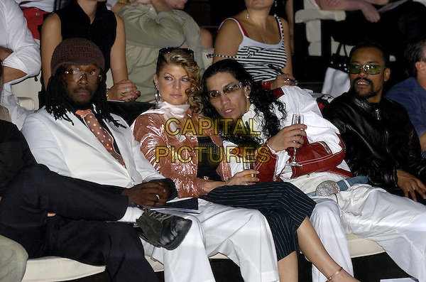 BLACK EYED PEAS - FERGIE.Armani Fashion Show.July 30th, 2004.*UK Sales Only*.sunglasses, shades, champagne, drinking, pink jacket, half length.www.capitalpictures.com.sales@capitalpictures.com.© Capital Pictures.