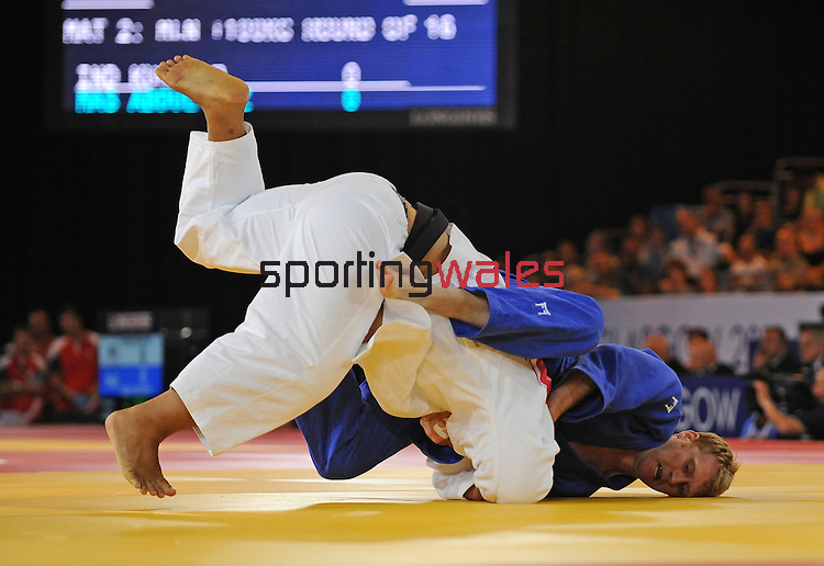 Wales Mark Shaw in action against Samoa's Derek Sua<br /> <br /> Photographer Ian Cook/Sportingwales<br /> <br /> 20th Commonwealth Games - Judo -  Day 3 - Saturday 26th July 2014 - Glasgow - UK