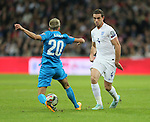 England's Jordan Henderson tussles with Slovenia's Kevin Kampl<br /> <br /> - International European Qualifier - England vs Slovenia- Wembley Stadium - London - England - 15th November 2014  - Picture David Klein/Sportimage