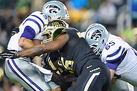 Baylor defensive end K.J. Smith (56) sacks Kansas State quarterback Jake Waters (15) during an NCAA football game, Saturday, December 06, 2014 in Waco, Tex. Baylor defeated Kansas State 38-27. (Mo Khursheed/TFV Media via AP Images)