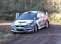 Quintin Milne - Martin Forrest in a Mitsubishi Evolution competing at Junction 6 on the Munro Scotch Beef Millbuie Special Stage 1 on the 2014 Arnold Clark/Thistle Hotel Snowman Rally, supported by Highland Office Equipment, part of Capital Document Solutions which was organised by Highland Car Club and based in Inverness on 22.2.14; Round 1 of the 2014 RAC MSA Scottish Rally Championship sponsored by ARR Craib Transport Limited.
