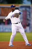 Chattanooga Lookouts third baseman Miguel Sano (24) warmup throw to first during a game against the Jacksonville Suns on April 30, 2015 at AT&T Field in Chattanooga, Tennessee.  Jacksonville defeated Chattanooga 6-4.  (Mike Janes/Four Seam Images)