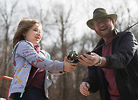 NWA Democrat-Gazette/CHARLIE KAIJO Alivia Steeves, 8, of Centerton and Gene Hutto of Siloam Springs (from left) fish, Sunday, January 6, 2019 at Lake Atalanta in Rogers.