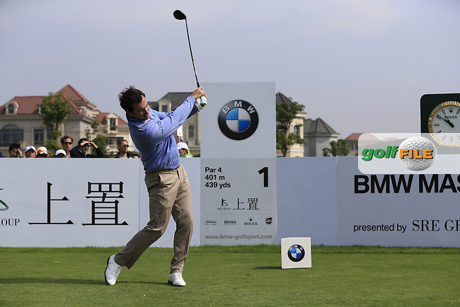 Gonzalo Fernandez-Castano (ESP) tees off the 1st tee to start his match during Saturday's Round 3 of the 2013 BMW Masters presented by SRE Group held at Lake Malaren Golf Club, Shanghai, China. 26th October 2013.<br /> Picture: Eoin Clarke/www.golffile.ie