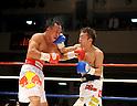 (L-R) Pornsawan Porpramook (THA), Akira Yaegashi (JPN), OCTOBER 24, 2011 - Boxing : Akira Yaegashi of Japan hits Pornsawan Porpramook of Thailand during the tenth round of the WBA minimumweight title bout at Korakuen Hall in Tokyo, Japan. (Photo by Mikio Nakai/AFLO)
