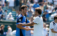 Bobby Burling (left) and Niko Kranjcar (right) shake hands after the final whistle.