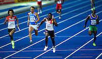 22 AUG 2009 - BERLIN, GER - Harry Aikines Aryeetey (GBR) takes the team to a silver medal in the Mens 4 x 100m Relay Final at the World Athletics Championships (PHOTO (C) NIGEL FARROW)