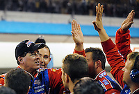 Nov. 13, 2009; Avondale, AZ, USA; NASCAR Camping World Truck Series driver Ron Hornaday celebrates with his crew members after clinching the 2009 championship following the Lucas Oil 150 at Phoenix International Raceway. Mandatory Credit: Mark J. Rebilas-