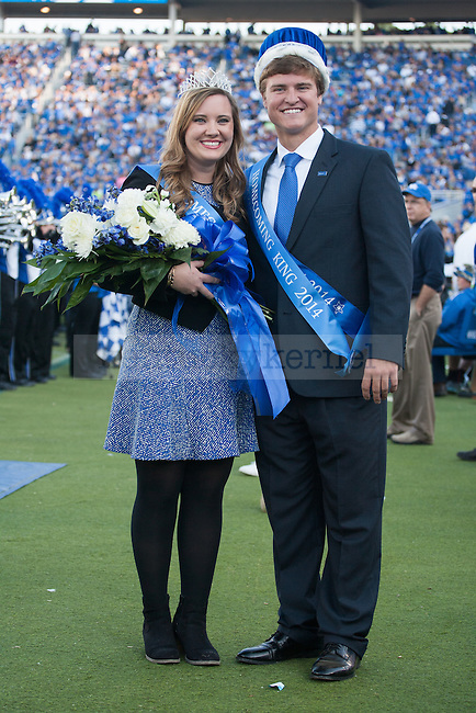 The 2014 UK Homecoming Queen and King, Lee Foster and Colby Hall, pose for a photo during halftime of the Kentucky Wildcats game against the Mississippi State Bulldogs at Commonwealth Stadium on Saturday, October 25, 2014 in Lexington, Ky. Mississippi leads Kentucky 17-10. Photo by Adam Pennavaria | Staff