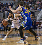 Nevada forward Cody Martin (11) drives against San Jose State forward Noah Baumann (20) in the first half of an NCAA college basketball game in Reno, Nev., Wednesday, Jan. 9, 2019. (AP Photo/Tom R. Smedes)