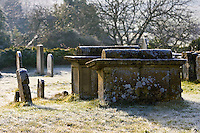 Hoar frost covered gravestones and tombs in Oxfordshire cemetery, England, United Kingdom