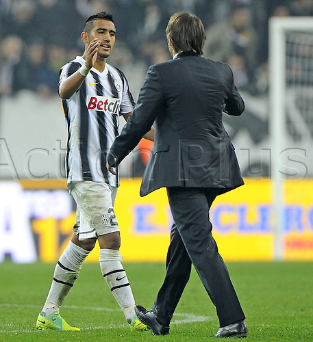 04 12 2011 Turin, Italy.  Series A Juventus versus Cesena Photo Arturo Vidal is high-fived by coach Antonio Conte