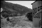 Goose #4 (back corner of freight box) on track at the Bilk road crossing with stock car on siding.  Corner of stock pens is just beyond the stock car.<br /> RGS  Blk, CO  ca. 1944