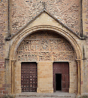 Carved tympanum of the Last Judgement, early 12th century, by the Master of the Tympanum, above the doors in the portico on the West facade of the Abbatiale Sainte-Foy de Conques or Abbey-church of Saint-Foy, Conques, Aveyron, Midi-Pyrenees, France, a Romanesque abbey church begun 1050 under abbot Odolric to house the remains of St Foy, a 4th century female martyr. The church is on the pilgrimage route to Santiago da Compostela, and is listed as a historic monument and a UNESCO World Heritage Site. Picture by Manuel Cohen