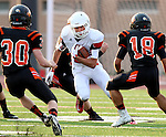 SIOUX FALLS, SD - AUGUST  28: Alex Wickersham #21 from Brandon Valley looks for room around the defense of Josh Garry #30 and Logan Eckhoff #18 from Washington in the first half of their game Friday night at Howard Wood Field. (Photo by Dave Eggen/Inertia)
