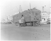 3/4 view of Pacific Electric Interurban Express car #1449 being loaded/unloaded in an L. A. street.<br /> Pacific Electric  Los Angeles, CA