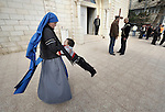 Sister Mariam Almiron, a member of the Sisters of the Incarnate Word from Argentina, spins a small child around following Sunday Mass at the Holy Family Catholic Parish in Gaza City. There are only some 3,000 Christians in Gaza, of which just over 200 are Catholic..