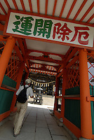 "Visitors to Yakuouin temple on Mount Takao. The sign says ""Good luck in, bad luck out""."